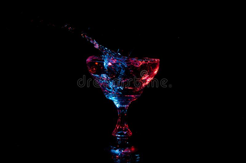 Water splashing out from fancy glass royalty free stock image