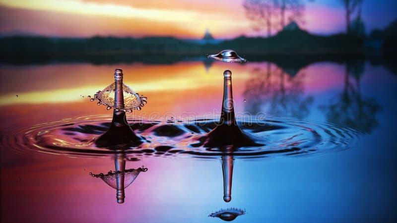 Water splashing in pool at sunset royalty free stock image