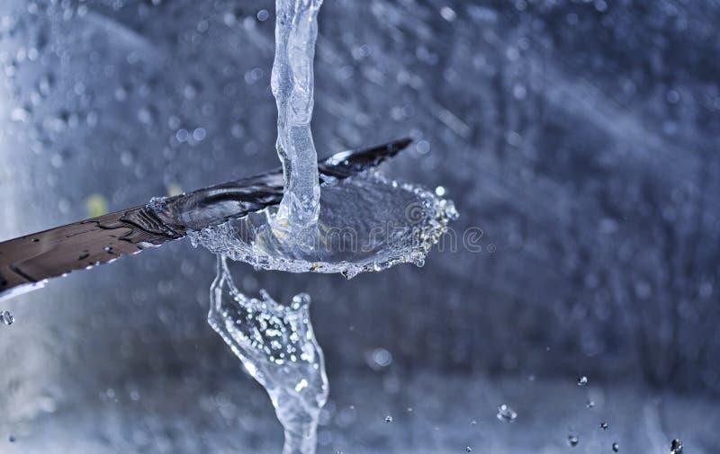Water splashing while Washing Knife royalty free stock photo
