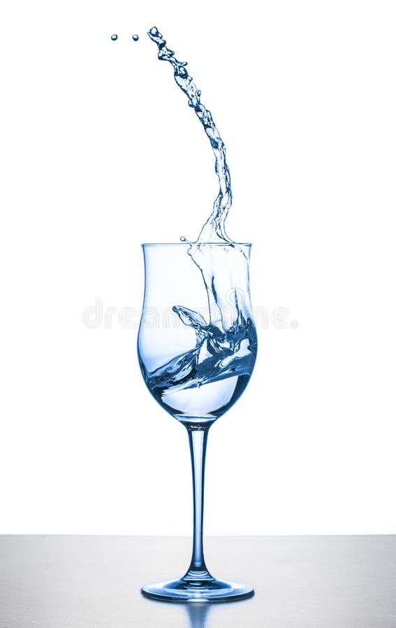 Water splashing from glass on white background. Water splashing from wineglass on white background stock image