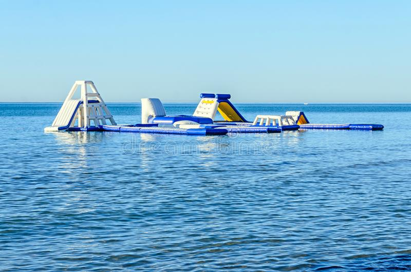 Water sport air slide on sea water near beach with sand.  royalty free stock photography