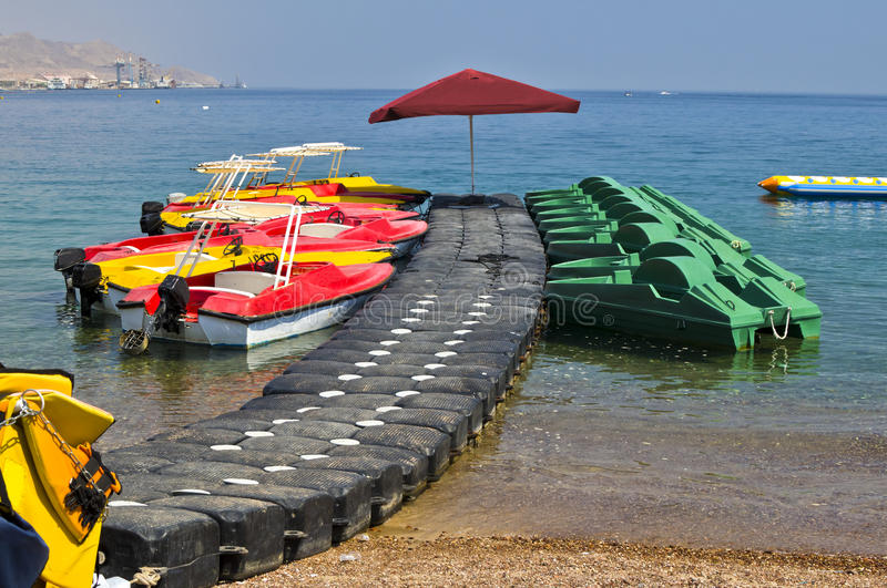 Water sport facilities on a beach, Eilat. Water sport and recreation facilities are near resort hotels in Eilat city, Israel stock photo