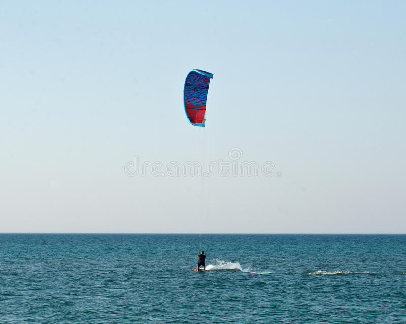 Water sport, kiteboarding. On Lake Michigan in warm fall day stock image