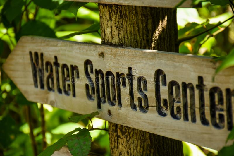 Water sports center wooden sign at the tropical island. At Maldives royalty free stock images