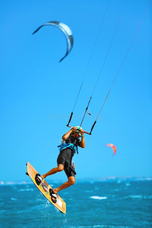 Water Sports. Kiteboarding, Kitesurfing In Ocean. Extreme Sport. Water Sports. Kiteboarding, Kitesurfing. Kiter Jumping On Waves In Ocean. Extreme Sport Action royalty free stock image