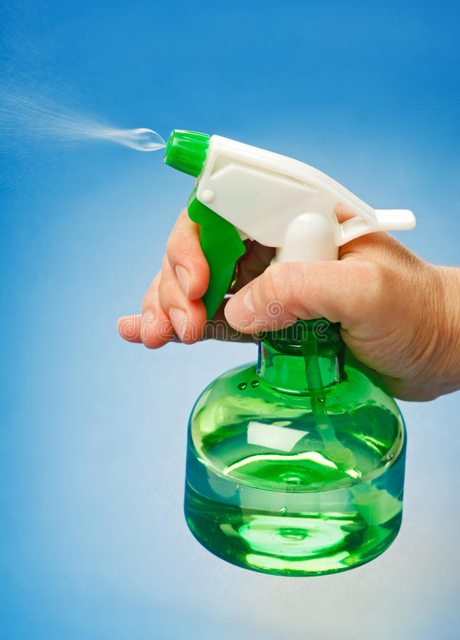 Download Water spraying stock photo. Image of blue, holding, household - 19089350