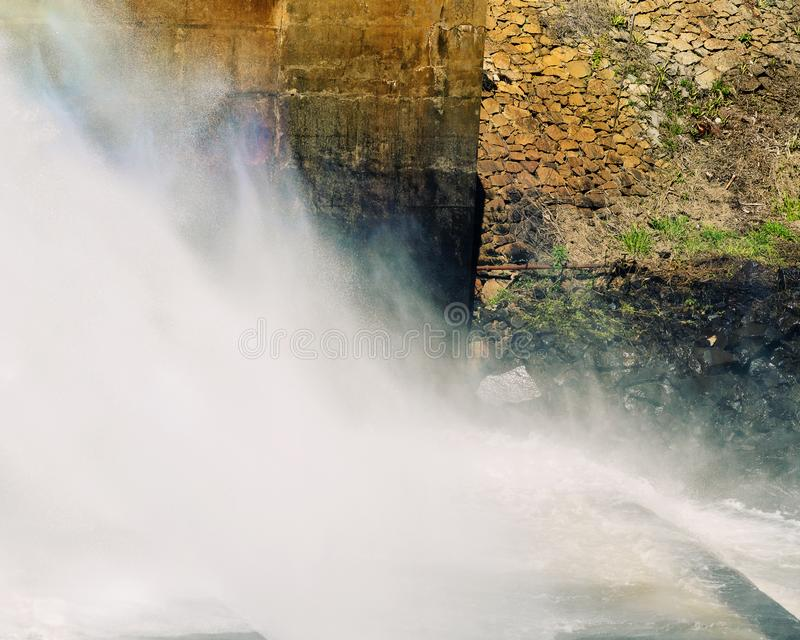 Water Spraying With Force From A Dam Wall. Lake Tinaroo dam in Australia stock photography