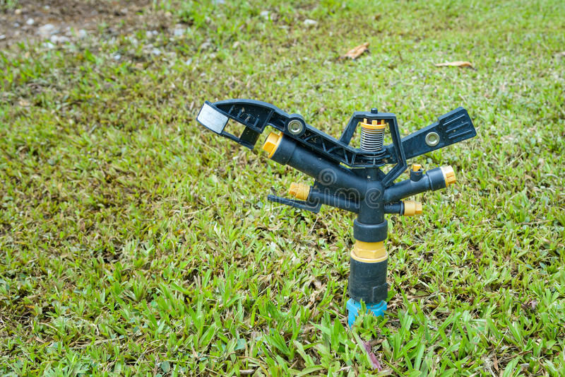 Water springer on ground in garden stock photos