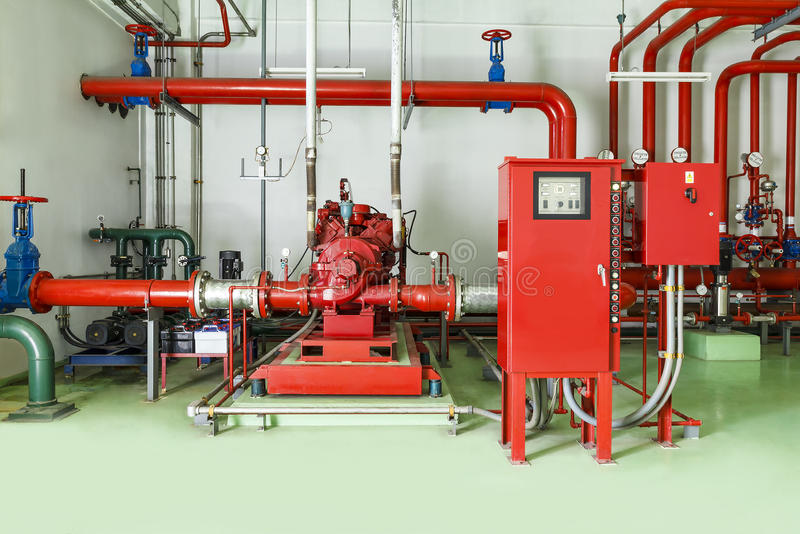 Water sprinkler and fire alarm fighting system. In factory royalty free stock photography
