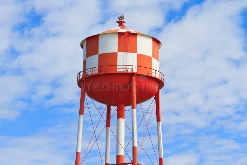 Water står hög med röda och vitband arkivbild