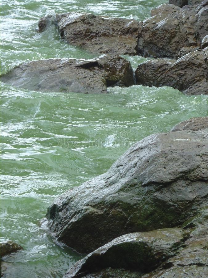 Water stands between large stones. Dnepr River. Summer sunny day. Ukraine royalty free stock photo