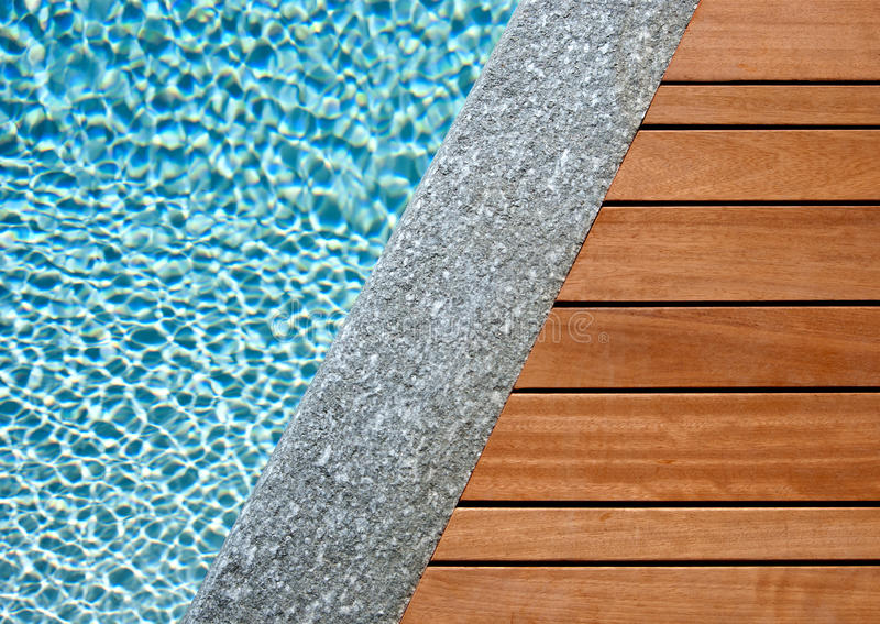 Water, stone and wood divided by a diagonal royalty free stock image
