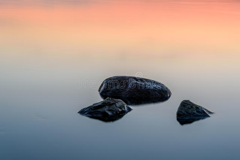 Water stones sunset texture background royalty free stock photo