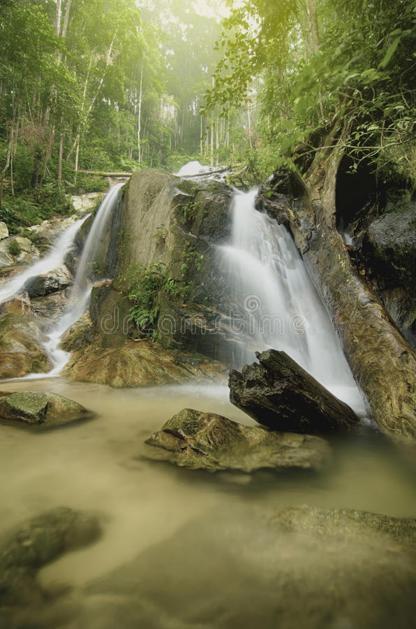 Water stream and beautifull waterfall. clear water and sunlight effect royalty free stock images