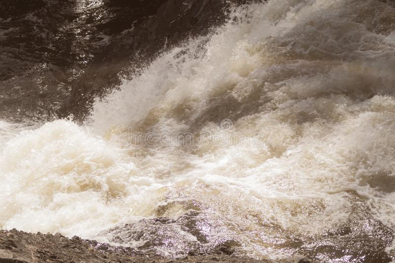 Water stream with foam. falling river water. waterfall flow. abstract water background royalty free stock photography