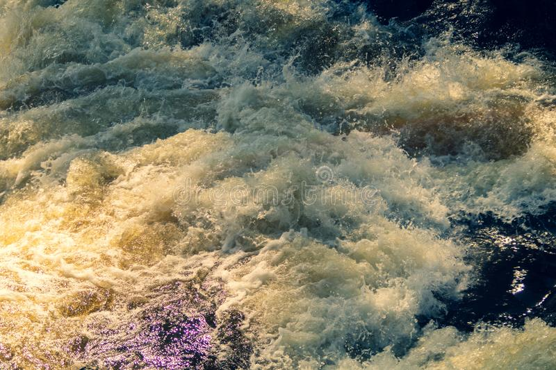 Water stream with foam. falling river water. waterfall flow. abstract water background. Water stream with foam. falling river water. waterfall flow. water stock photography