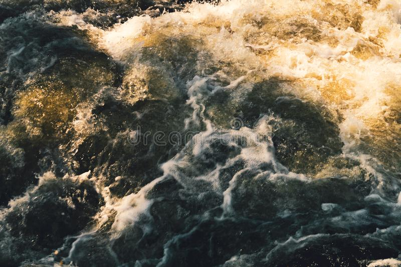 Water stream with foam. falling river water. waterfall flow. abstract water background. Water stream with foam. falling river water. waterfall flow. water royalty free stock photography