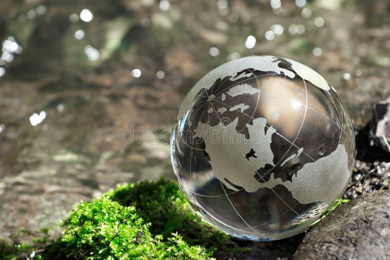 Water stream, globe, ecology. Closeup stock image
