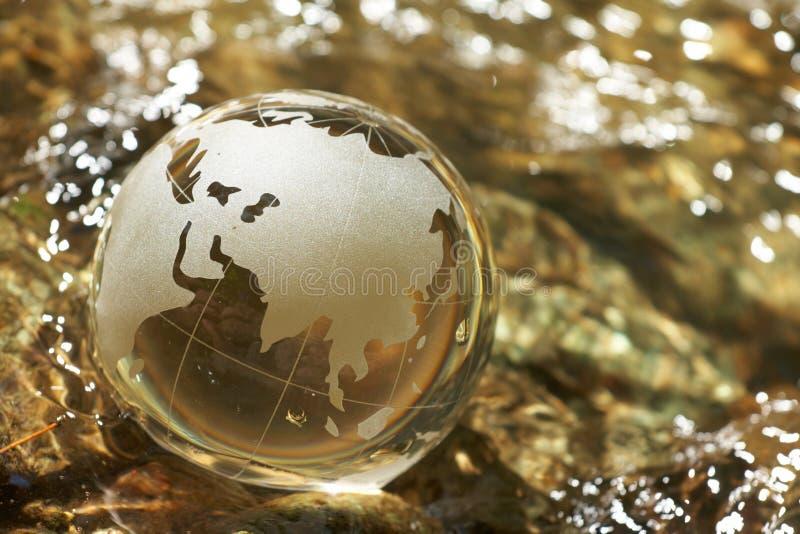 Water stream, globe, ecology. Closeup royalty free stock photography