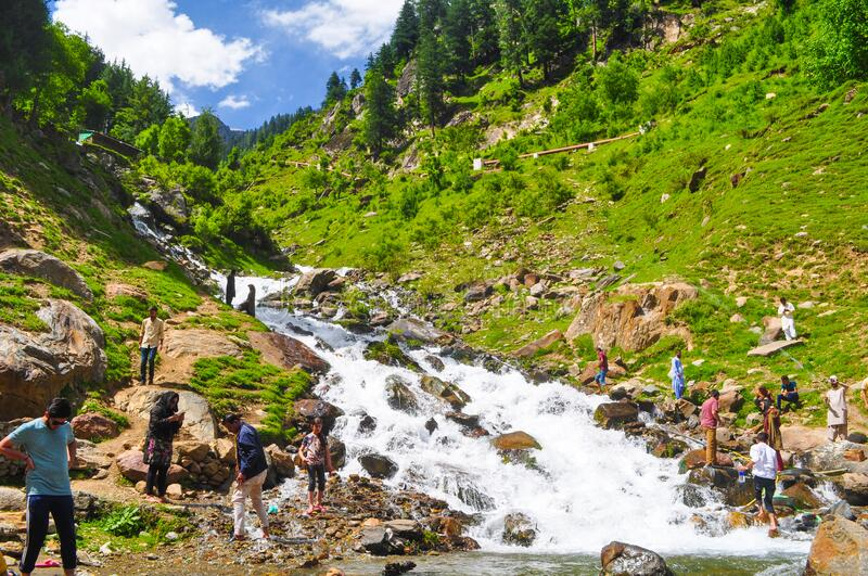 Water Stream and trees in Azad jammu and kashmir. Tourists enjoying water stream during daytime in Azad jammu and kashmir, Pakistan royalty free stock photos