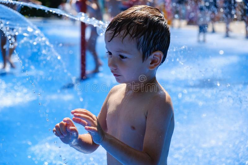 Water summer child fun fountain,  childhood stock image