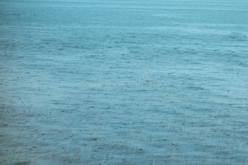 Water surface with drops and ripples. Lake or pond raining background royalty free stock photos