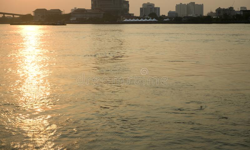 Water surface with ripples and sunlight reflections stock photography