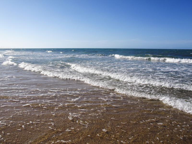 Water surface of sea or ocean with horizon and blue sky or sea w stock photo