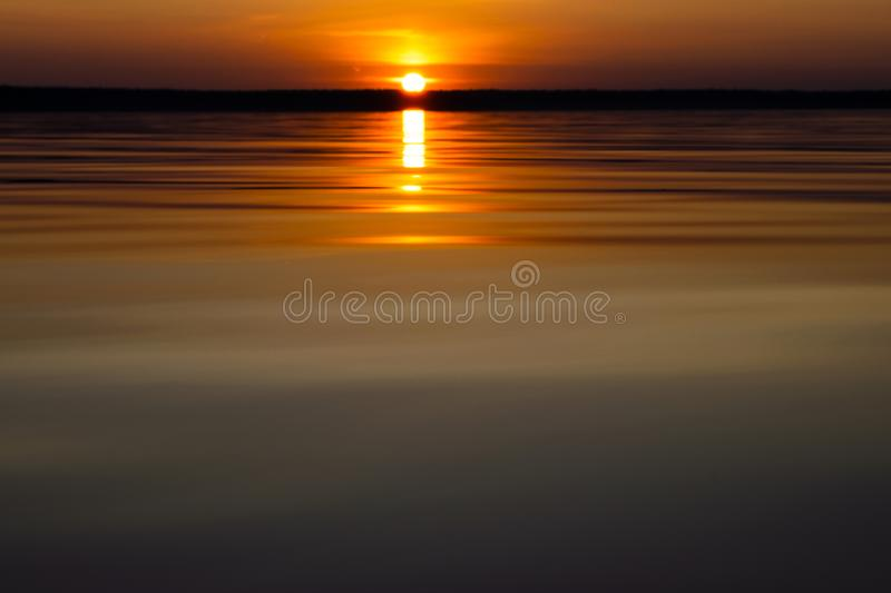 Water surface. View of a Sunset sky background. Dramatic gold sunset sky with evening sky clouds over the sea. View of a Crystal c stock photos