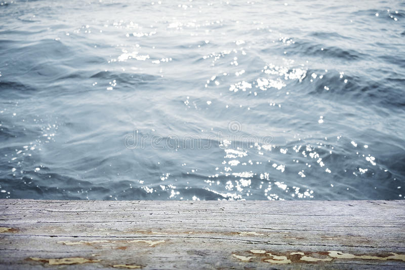 Water surface with wooden table in front. Water surface with wooden table royalty free stock photography