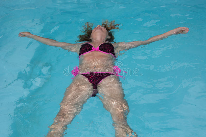 Water swimming pool relaxing girl in holiday stock image