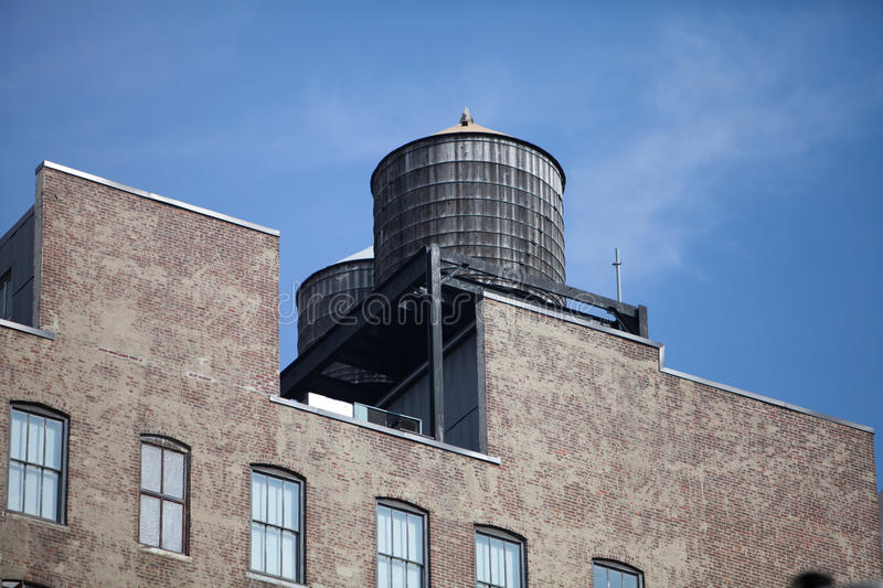 Water tank. S on the roofs of New york stock images
