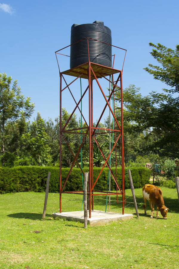Water tank. Plastic water tank kept on metallic platform at a farm stock photography
