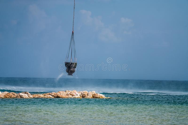 Water tank below a Kamov, Ka-32A11BC during fire fighting mission royalty free stock photos