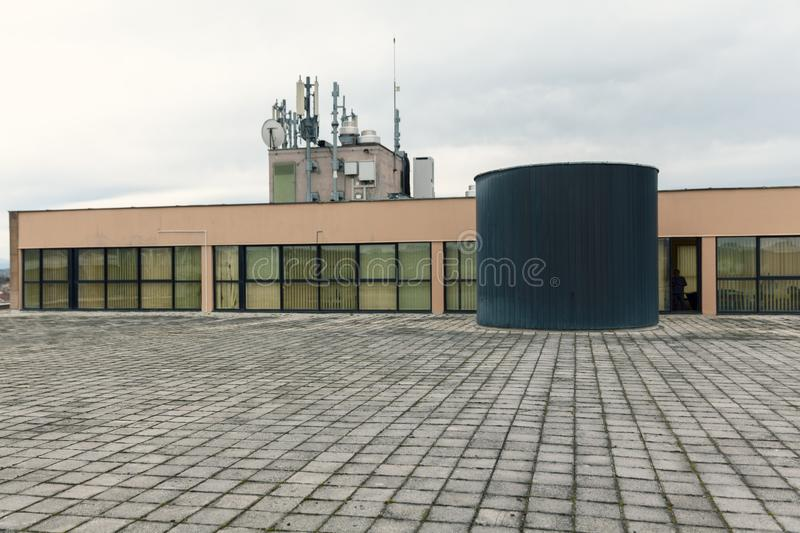 Water tank on the flat roof. Black water tank on the flat roof stock photo