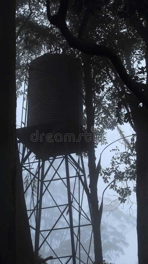 Water tank on a foggy morning royalty free stock photos