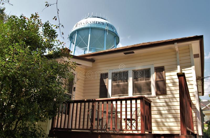 Andy Griffith Childhood Home. The water tank in Mt. Airy, North Carolina is painted with a silhouette of Andy and Opie Taylor of the Andy Griffith Show and is stock images