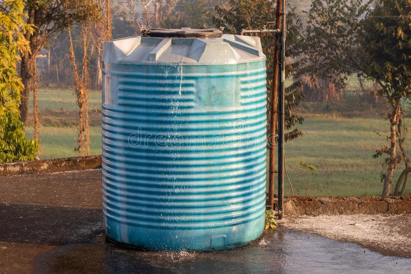 Water tank overflowing, fitted in house. Water tank overflowing, wasting water stock photography