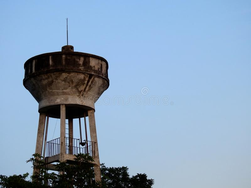 Water tank, water supply tank for Consume with blue sky background. Top leaves are below stock images