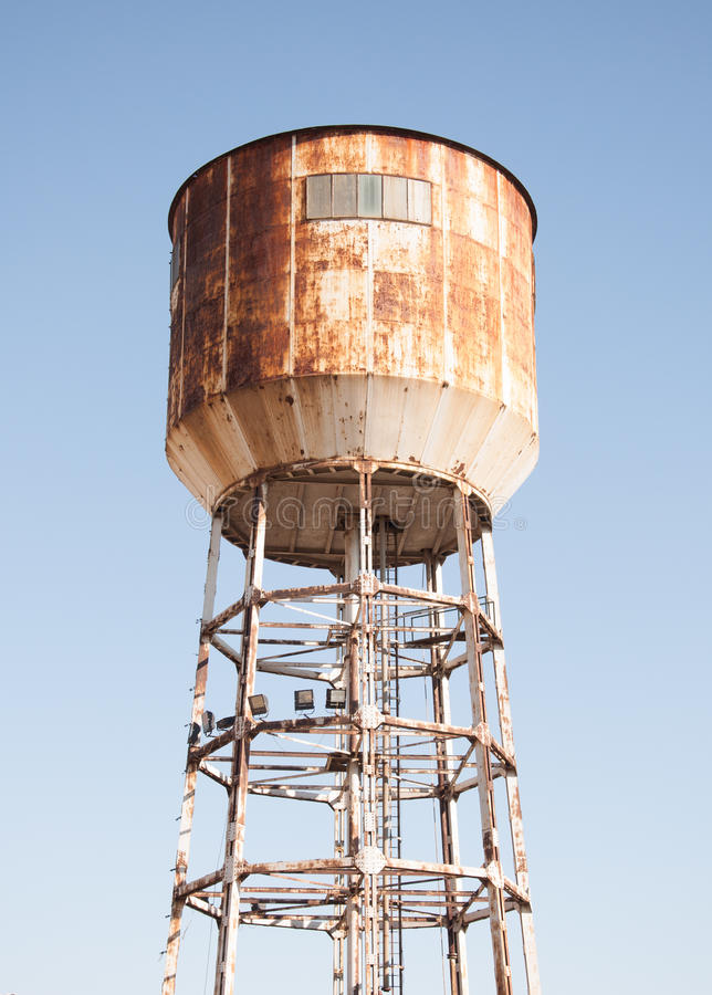 Water tank tower. Against blue sky royalty free stock photo