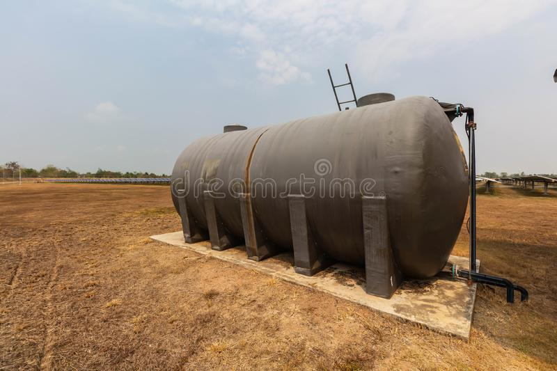 Water tank for washing, Solar power plants use water that is free of chemicals to clean solar panels to avoid environmental. Impacts stock photo