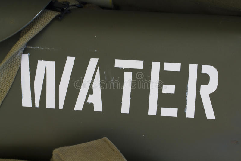 Water tank writing. The stenciled writing on a water tank on an American military vehicle stock image