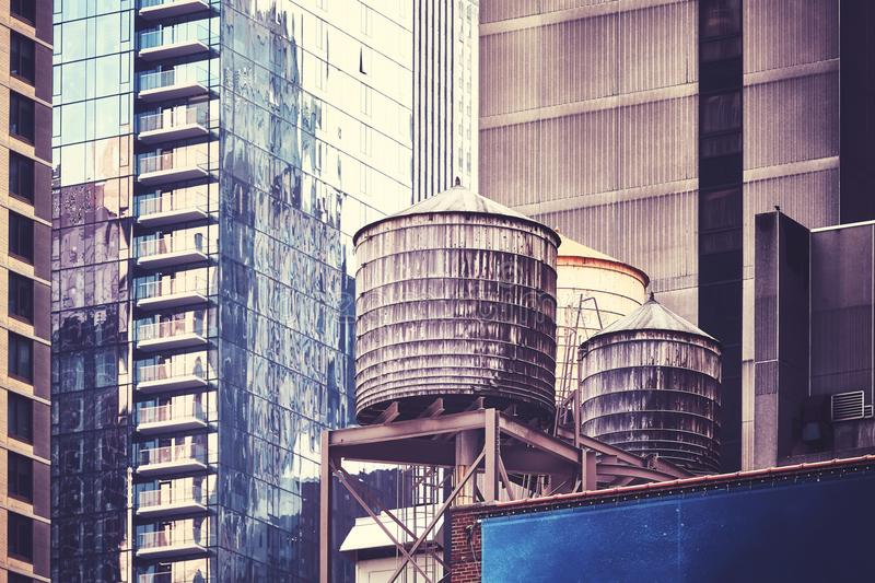 Water tanks, one of the New York City symbols. Water tanks on a roof, one of the New York City symbols, color toned picture, USA stock photos
