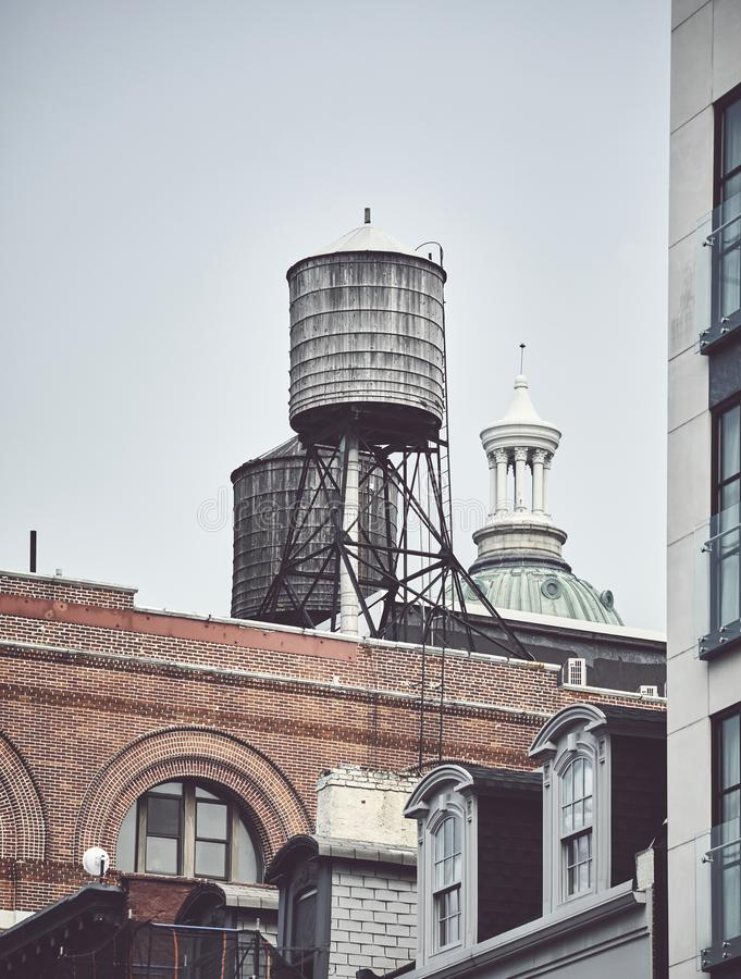 Water tanks on a roof of a building in downtown New York stock photo