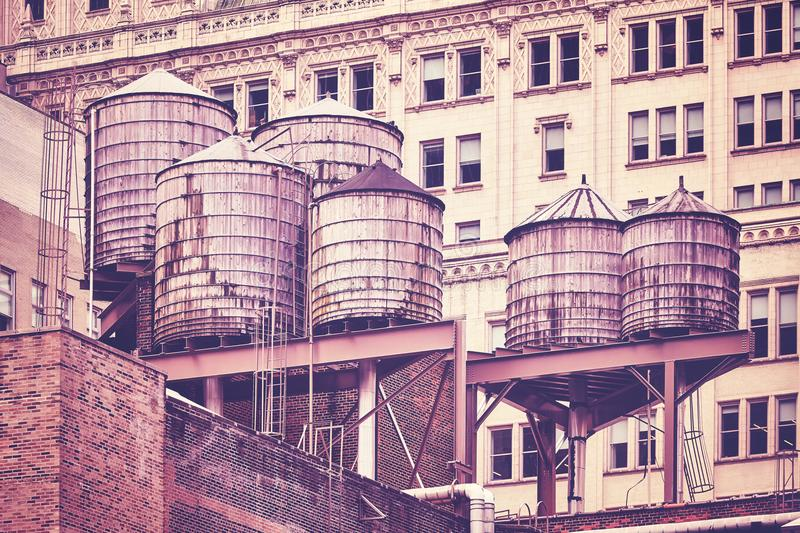 Water tanks on a roof, New York City. stock photo