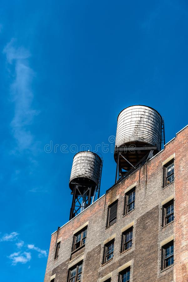 Water tanks in Tribeca in New York. Low angle view of water tanks in Tribeca North District of New York City royalty free stock images