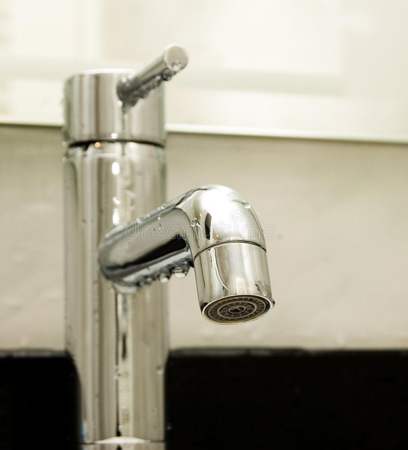Water Tap. Chrome Water tap with drops of water on it royalty free stock photos