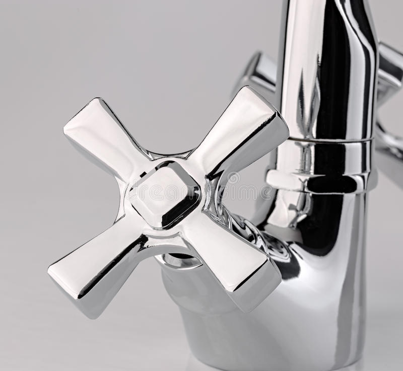The water tap, faucet for the bathroom and kitchen mixer, isolated on a white background. Chrome-plated metal. royalty free stock photography