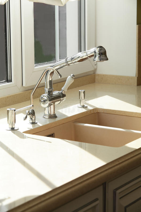 Water tap in modern interior. Stainless steel water tap in modern interior stock photo