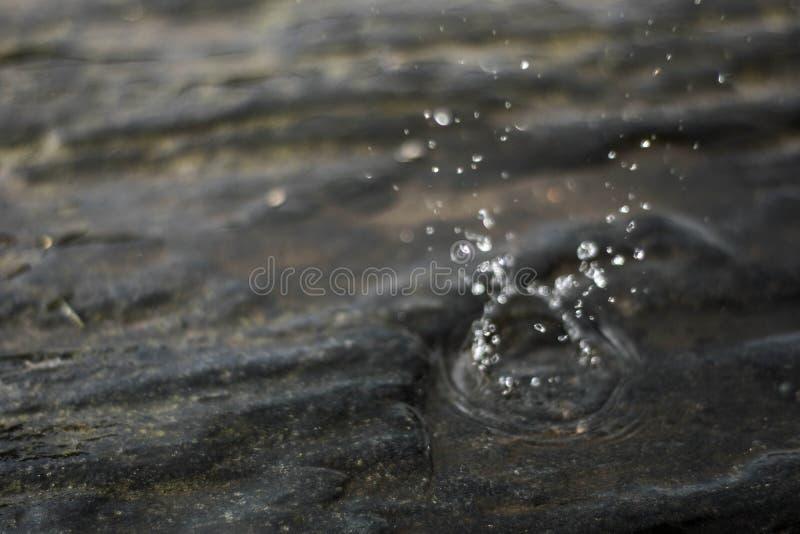 Water tappar fotografering för bildbyråer